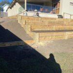 Raised garden beds on sloped ground Gold Coast backyard ideas.
