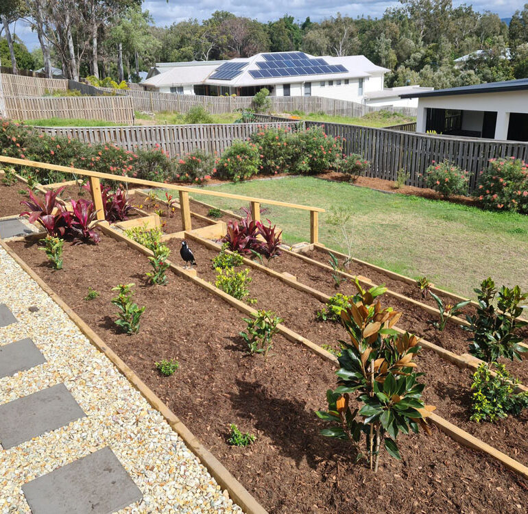 Raised garden beds on sloped ground Gold Coast backyard ideas.